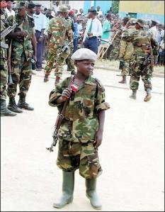 A child soldier in Bunia, Congo. A symbol of Paul Kagame's reign of terror in Eastern Congo.